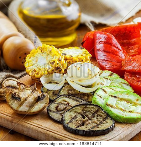 Grilled vegetables meal on a table. Tomato corn eggplant mushroom bell pepper marrow and onion prepared on a barbecue. Healthy food.