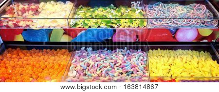 A variety of gummies and worms on store shelves