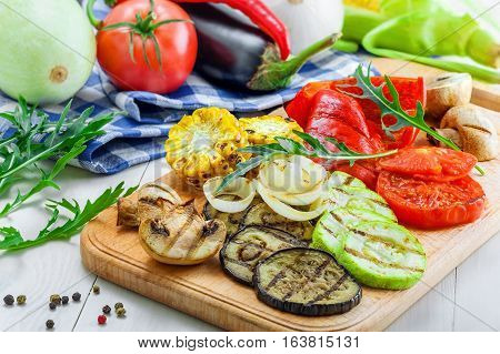 Set of grilled vegetables meal and ingredients: tomato corn eggplant mushroom bell pepper marrow and onion. Healthy organic food on a table.