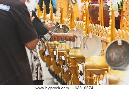 Make merit and give food offerings to Buddhist monks or Donate money on The End of Buddhist Lent Day in Chak Phra Festival (Pulling the Buddha ) from Surat Thani ( Thailand )