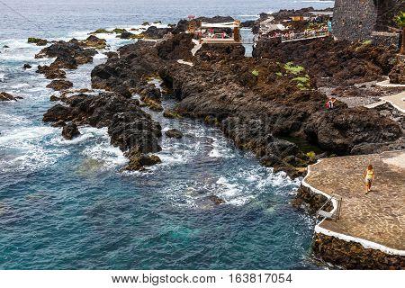 Garachico, Tenerife Island, Spain, 08 June 2015: Natural Volcanic Pools Visited By Tourists In Garac
