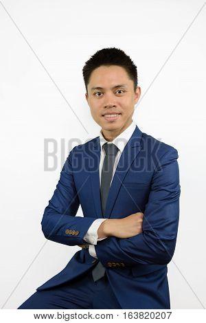 Asian Man In Blue Suit Cross Arm