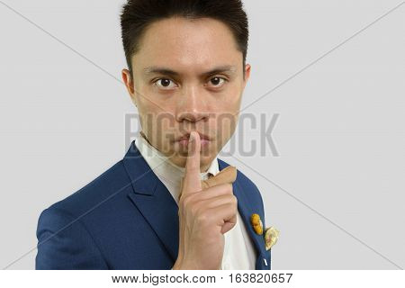 Man Places Finger On Lips Body Language