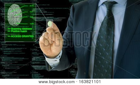 Businessman pressing a fingerprint scanner access granted with computercode background