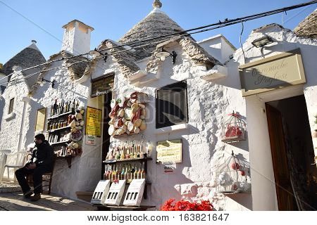 ALBEROBELLO, APULIA, ITALY - JANUARY 02, 2017 - Shop selling typical local products inside the traditional trulli houses