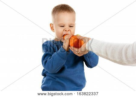 Happy Baby Boy Eating Carrot, Isolated