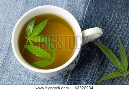 Marijuana Herbal Tea And Cannabis Leaves