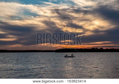 Fishing on a lake at sunset in Oklahoma.