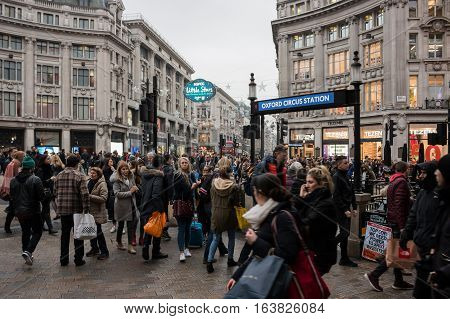 London, UK - 19 December 2016: Busy Oxford Circus full of shoppers in the Christmas period