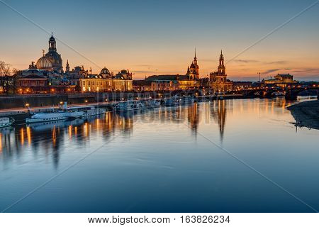 The old town of Dresden with the river Elbe at sunset