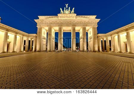 The famous Brandenburg Gate in Berlin illuminated at night