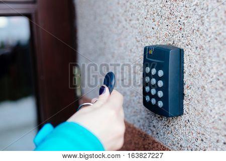 Woman Opening House Doors