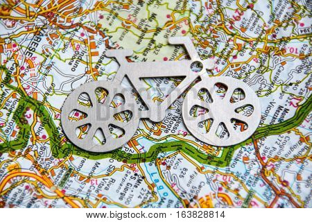bycicle silhouette on the background of a geographic map
