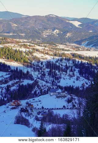 View from the mountain to the ski base and ski lift. Carpathian mountains. Slavske