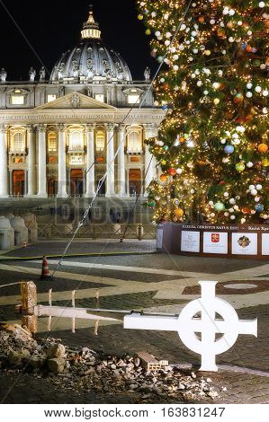 Vatican Italy - January 1 2017: St. Peter's Square in Rome prepared for Christmas featured some of the remains and the pinnacle of the Basilica of San Benedetto in Norcia fall with the recent earthquake. On the right the usual Christmas tree in the backgr