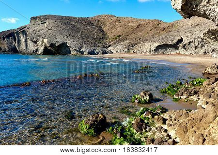 Volcanic rock-formations at Playa de Monsul. Famous beach in the Cabo de Gata-Nijar Natural Park. Province of Almeria. Spain