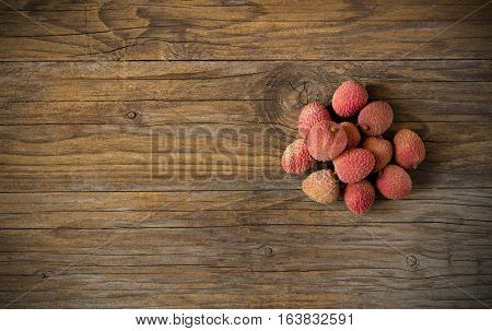 fresh fruits litchis on old wooden table