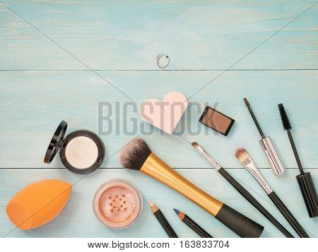 Set Of Makeup On Turquoise Wooden Background