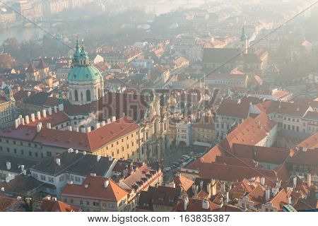 The red roof in Prague. Panoramic view of Prague from Prague Castle in winter day with dense fog in the city Czech Republic
