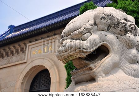 Dr. Sun Yat-sen Mausoleum (Zhongshan Ling) and stone lion in Purple Mountain, Nanjing, Jiangsu Province, China.
