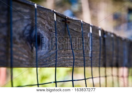 Detail of a wood and metal fence