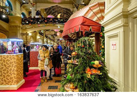 MOSCOW, RUSSIA - JANUARY 03, 2017: People at New Year Fair in GUM in Moscow. GUM is large shopping mall in the center of Moscow.