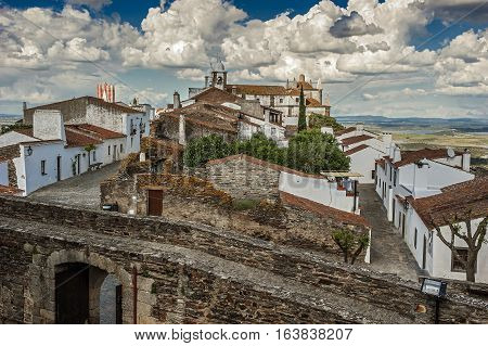 Monsaraz - a small border Portuguese fortress on top of a hill overlooking the vast expanses of the Alentejo vineyards olive groves and neighboring Spain Guadianu River a natural border of Spain and Portugal