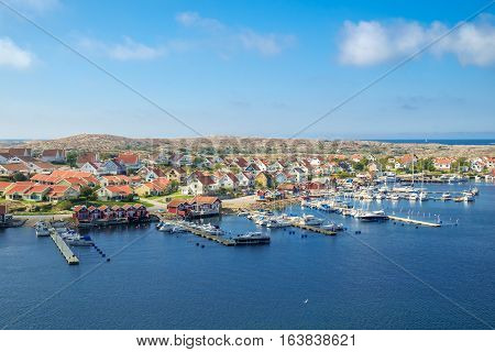 KUNGSHAMN, SWEDEN - SEPTEMBER 3, 2014: The Swedish west coast off-season in Kungshamn. Kungshamn is a popular summer time tourist destination on the Swedish west coast.