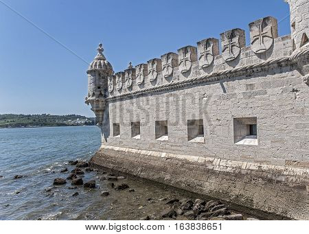 Portugal Lisbon . Torre - di - Belen - a fortified building ( Fort ) on an island in the river Tagus in the eponymous district of Lisbon .