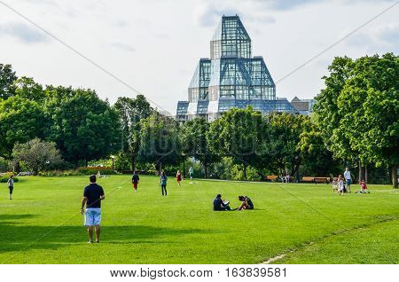 Ottawa, Canada - July 24, 2014: People in Majors Hill Park by National Gallery museum