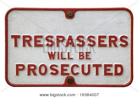 Old metal 'trespassers' sign, isolated on white.