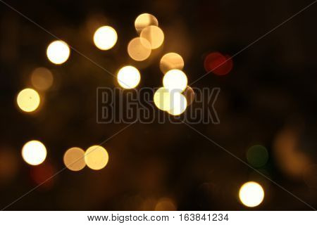Blurred golden background lights during christmass holiday