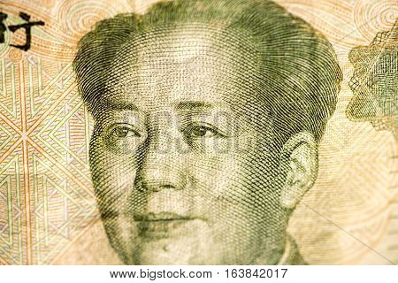 Face of Mao leader of China on a banknote of Chinese Yuan, as a symbol of modern economy