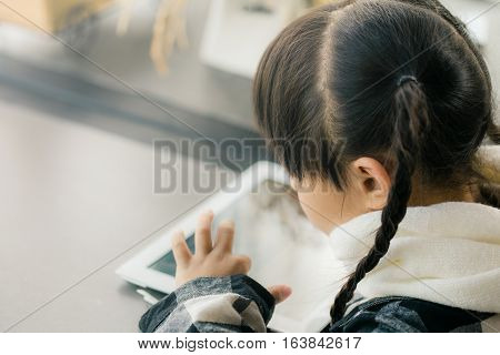 Beautiful asian girl using tablet early education and learning