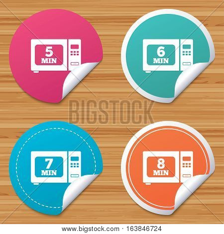 Round stickers or website banners. Microwave oven icons. Cook in electric stove symbols. Heat 5, 6, 7 and 8 minutes signs. Circle badges with bended corner. Vector