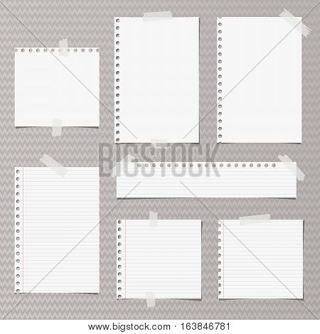 White note, notebook, copybook paper stripes and sheets stuck with sticky tape on gray wavy pattern.