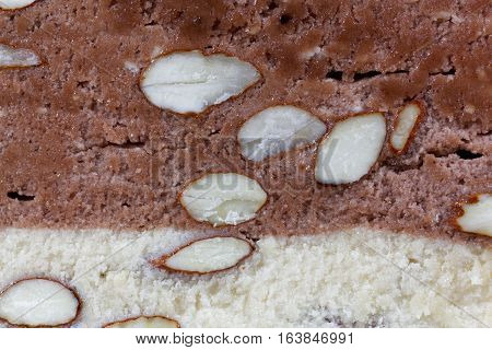 A macro photo of the surface of almond nougat from France.