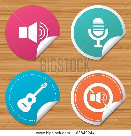Round stickers or website banners. Musical elements icons. Microphone and Sound speaker symbols. No Sound and acoustic guitar signs. Circle badges with bended corner. Vector