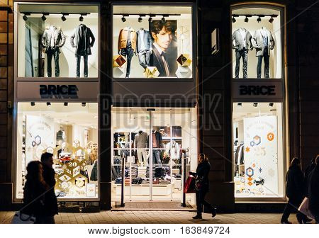 STRASBOURG FRANCE - DEC 20 2016: Brice masculine pret-a-porter store in French city with customers walking in front of the large windows admiring the clothes