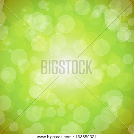 Positive spring background with bokeh. Shining gentle colors. The revival of nature. Pleasant green background.