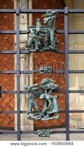Close-up view of small cast iron figures on the cathedral of St. Vitus in Prague, Czech Republic. Selective focus.