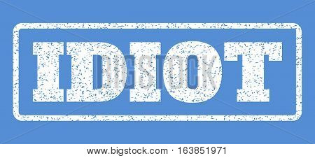 White rubber seal stamp with Idiot text. Vector caption inside rounded rectangular shape. Grunge design and unclean texture for watermark labels. Horisontal emblem on a blue background.