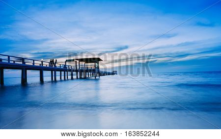 Blue sea waves and sky with airy clouds