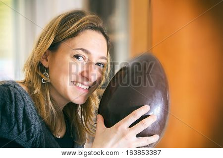 unwrapped easter egg woman happy smiling portrait