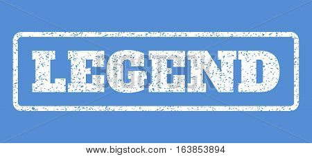 White rubber seal stamp with Legend text. Vector message inside rounded rectangular frame. Grunge design and dust texture for watermark labels. Horisontal sign on a blue background.