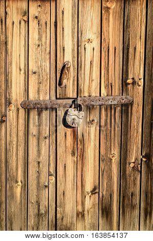 Metal Vintage Padlock On Aged Wood Texture
