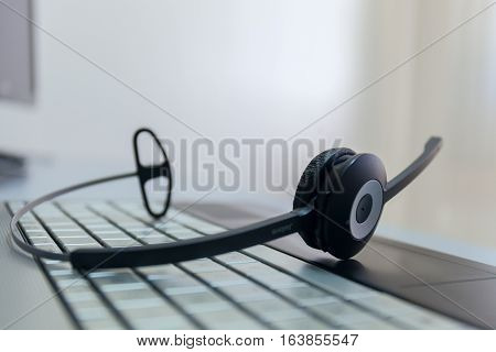 computer headphones on a keyboard of the notebook stock photo no man