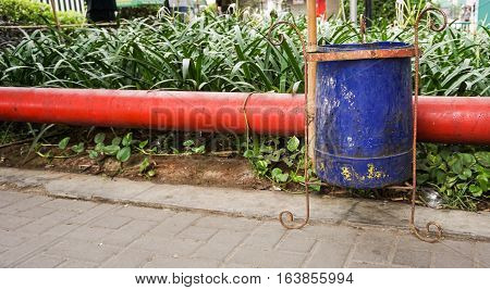 A blue trash can on the roadside photo taken in Semarang Indonesia java