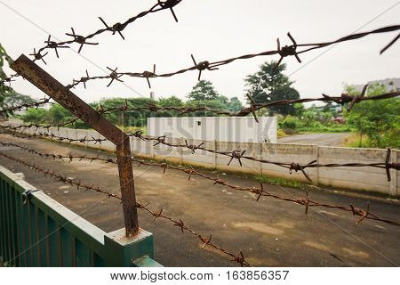 Barbed wire fence at Kariadi General Hospital photo taken in Semarang Indonesia java