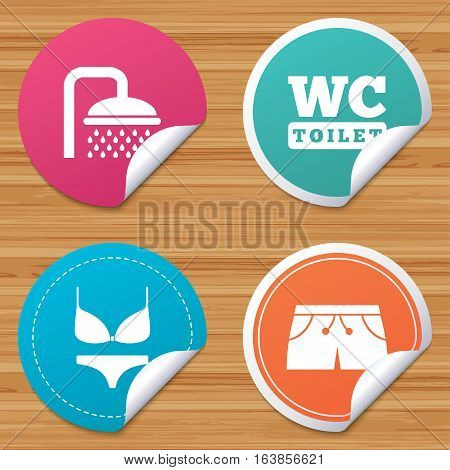 Round stickers or website banners. Swimming pool icons. Shower water drops and swimwear symbols. WC Toilet sign. Trunks and women underwear. Circle badges with bended corner. Vector